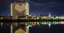 An image of Margaritaville Resort Casino Bossier City with windows lighted in a heart shape