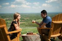 Couple tasting beer outdoors