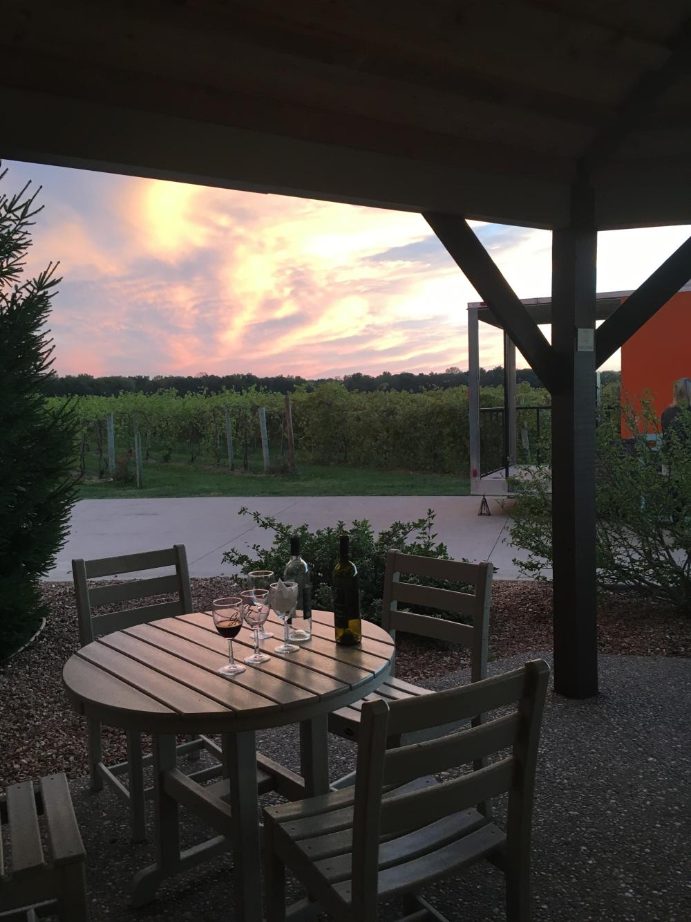 The sun sets among the vineyards of Country Heritage Winery in LaOtto.