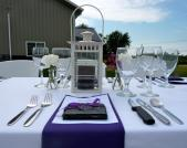 The table is set for a five course Winemaker's Dinner in the vineyards at Liberty Winery during Chautauqua in June.