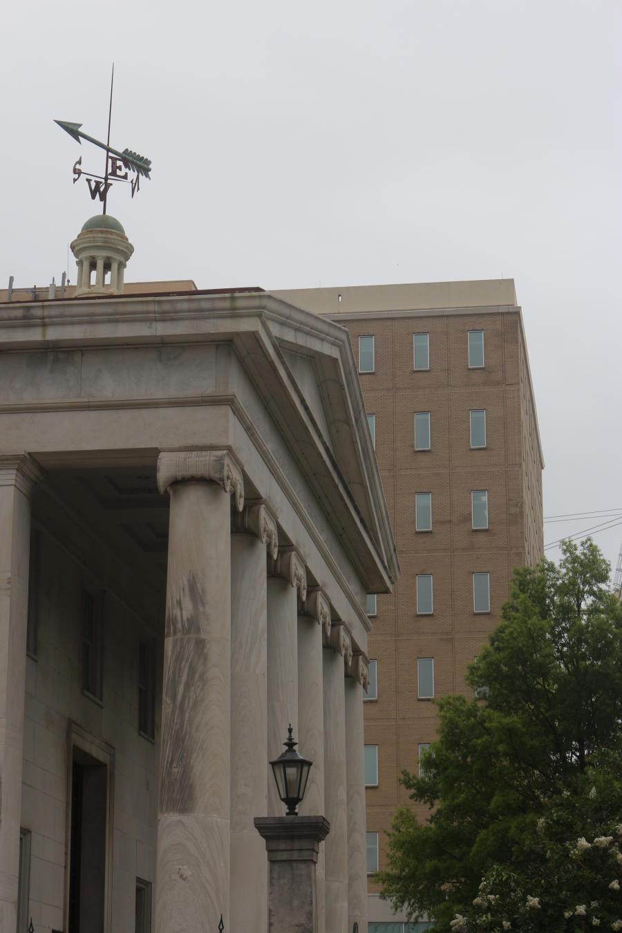 Once part of the previous Courthouse, the weather vane and cupula are now part of the First National Bank in Huntsville.