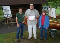 FRED KUEPPER, center, received a Tourism Ambassador Award at the Salmon River Fish Hatchery open house in Altmar in recognition of his contributions to Project Healing Waters, fishing education and conservation projects in Oswego County. Looking on are Salmon River Program Coordinator Fran Verdoliva and Janet Clerkin, Tourism and Public Information Coordinator for the Oswego County Department of Community Development, Tourism and Planning.