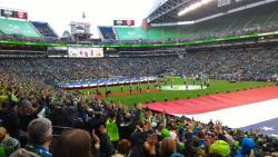 Packed stadium cheers on the Seattle Sounders