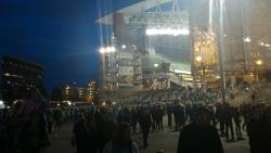 Crowds walking outside the stadium at night after a Seattle Sounders Soccer match
