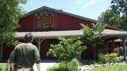 A man walking up to the Wheat State Wine Co in Winfield, KS