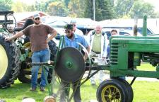 Spectators at last year's Crank It Up show gathered to watch how lumber was cut. (Photo by Elizabeth Macklen.)