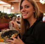 attractive young woman having breakfast at the Pancake Chef restaurant in SeaTac Washington