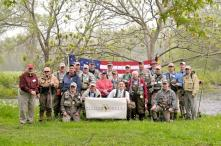 Soldiers and their guides from the Tug Hill/Black River Chapter of Trout Unlimited gathered for a weekend of fly fishing at Douglaston Salmon Run in Pulaski, during the Project Healing Water Fly Fishing program. (Photo by Jessica Trump, Oswego County Tourism Office.)