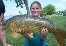 Hanna Hawkins holds a carp she caught during the St. Lawrence International Junior Carp Tournament, the nation's largest junior carp fishing contest, which takes place on the St. Lawrence River from Massena west to Ogdensburg.