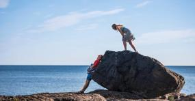 Couple by a rock