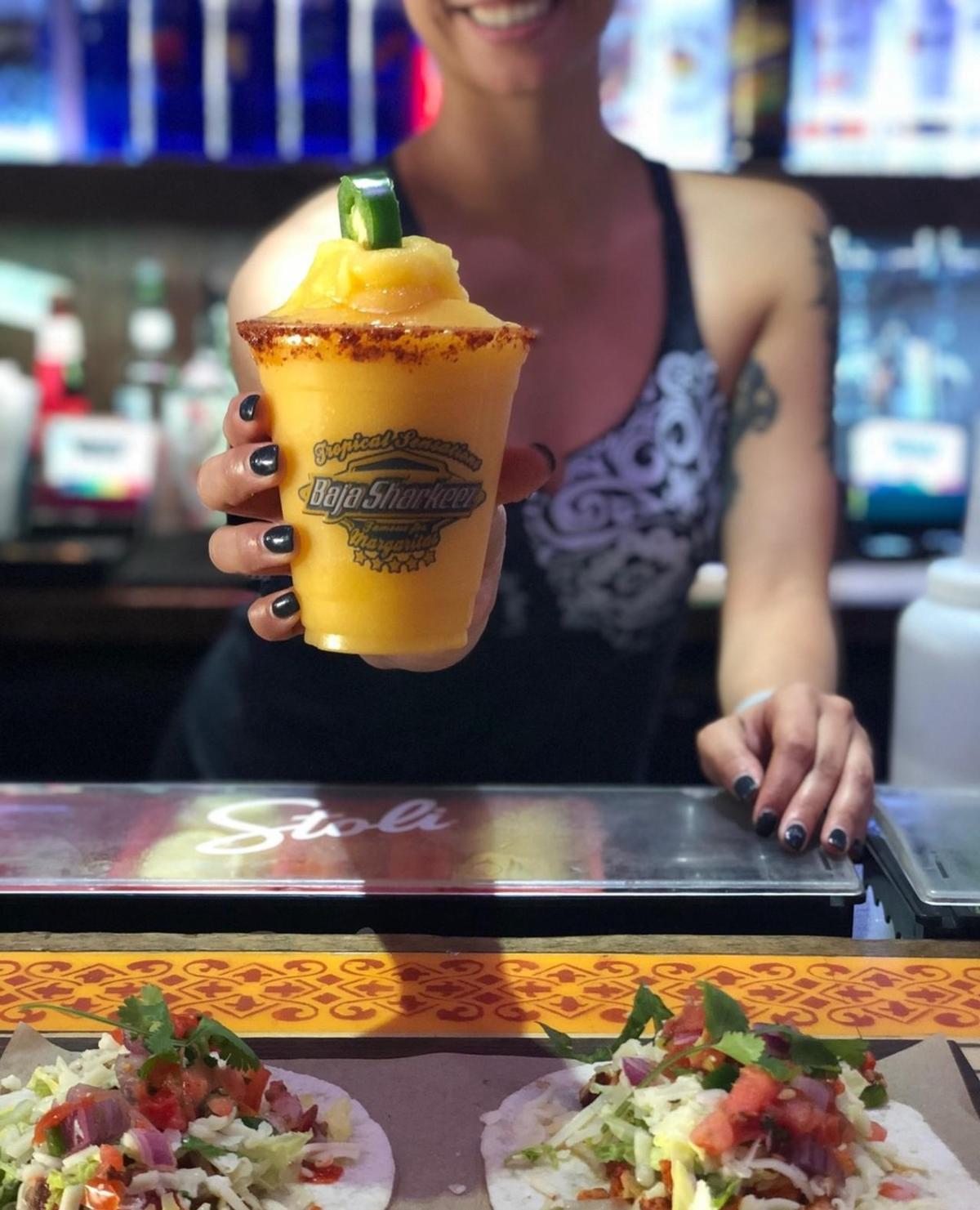 Bartender serving a drink at Baja Sharkeez in Huntington Beach