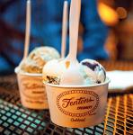 Fenton's Ice Cream cups and spoons on an outdoor tabletop