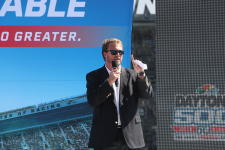 President of Daytona International Speedway, Chip Wile, is speaking at an event.