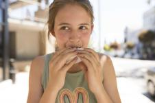 Woman eating dessert during the Rockridge Ice Cream & Gelato Tour