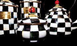 Checkered teapots stand on a shelf in Cayuga County