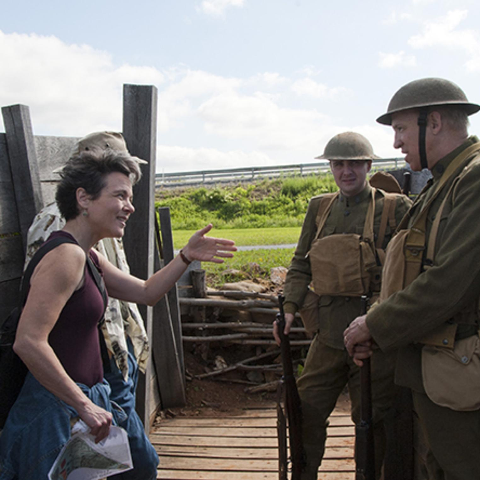 Visitors speak with WWI re-enactors in Allied Trench during Army Heritage Days