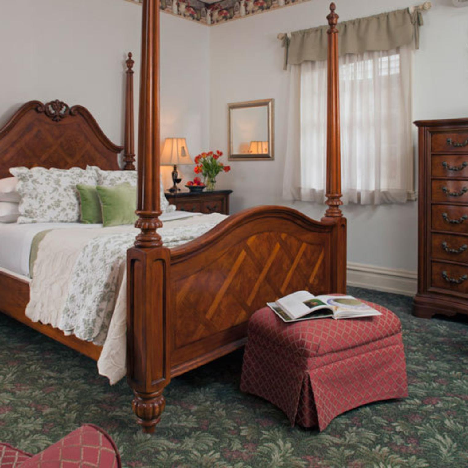 Queen-sized Bed in the Anna Woods Room