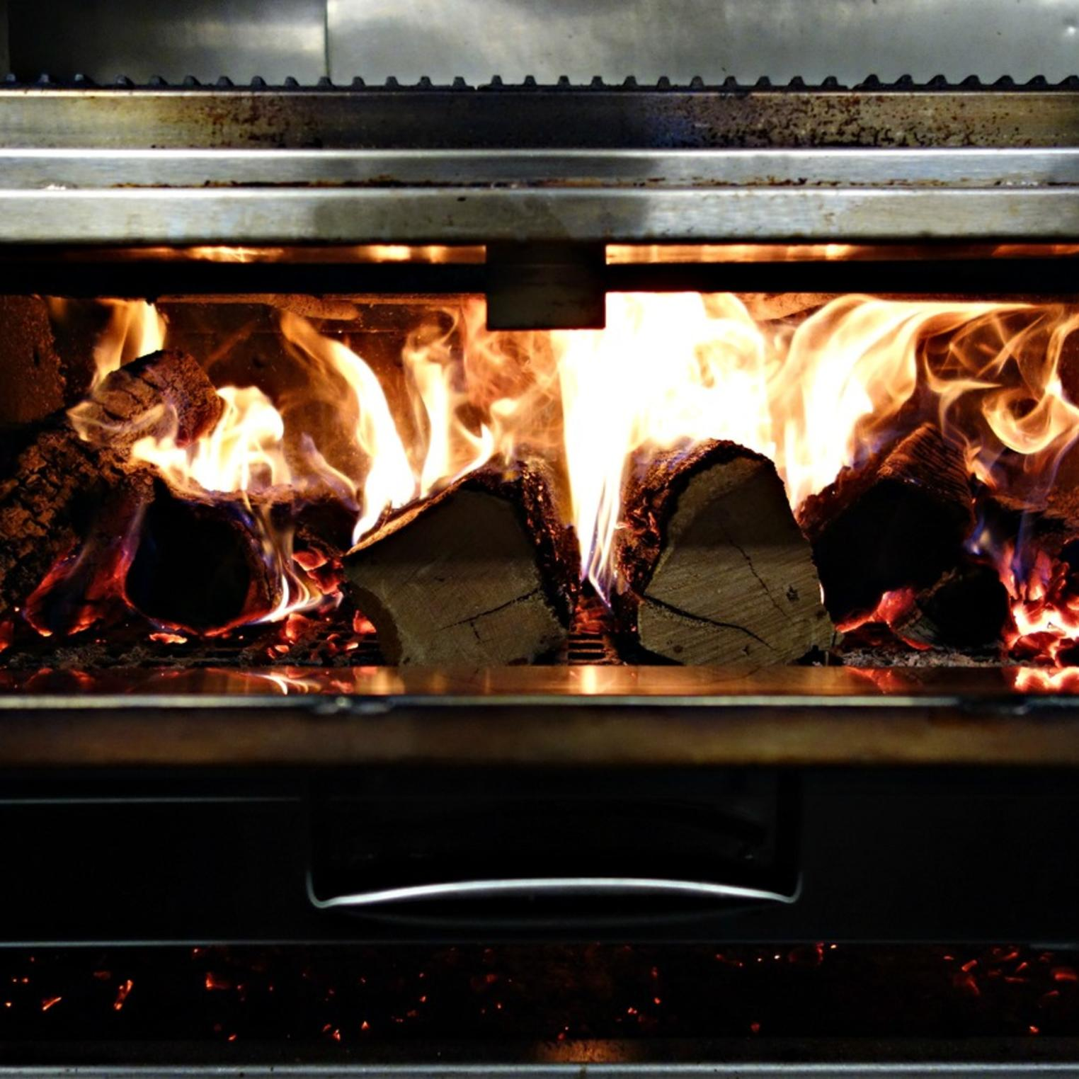 All steaks are cooked on a wood-fired grill.