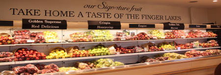 Fresh produce sits on refrigerated shelves in Red Jacket Orchards