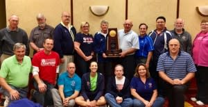 OVR Board members with NCAA Volleyball Trophy