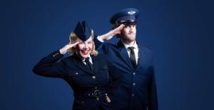 Man and woman in military uniform, saluting