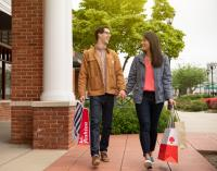 Couple shopping at the Leesburg Corner Premium Outlets