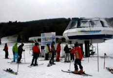 Skiers and Riders in the loading area of the Comet Express Chairlift. Photo: Courtesy of Drew Broderick