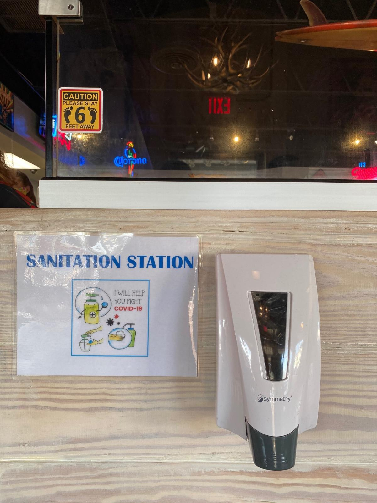 A sanitation station at Daddio's restaurant helps people adhere to increased hygiene practices.