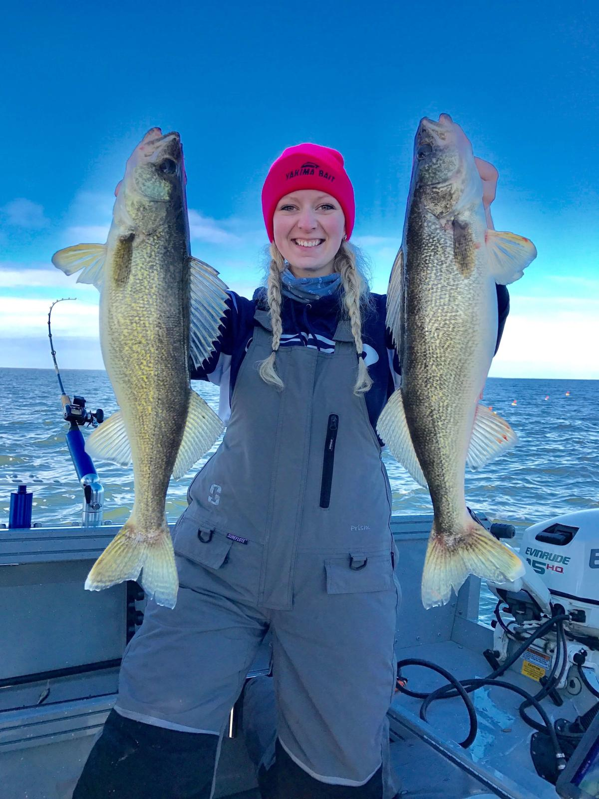 Women at Saginaw Bay Holding Two Walleye Fish