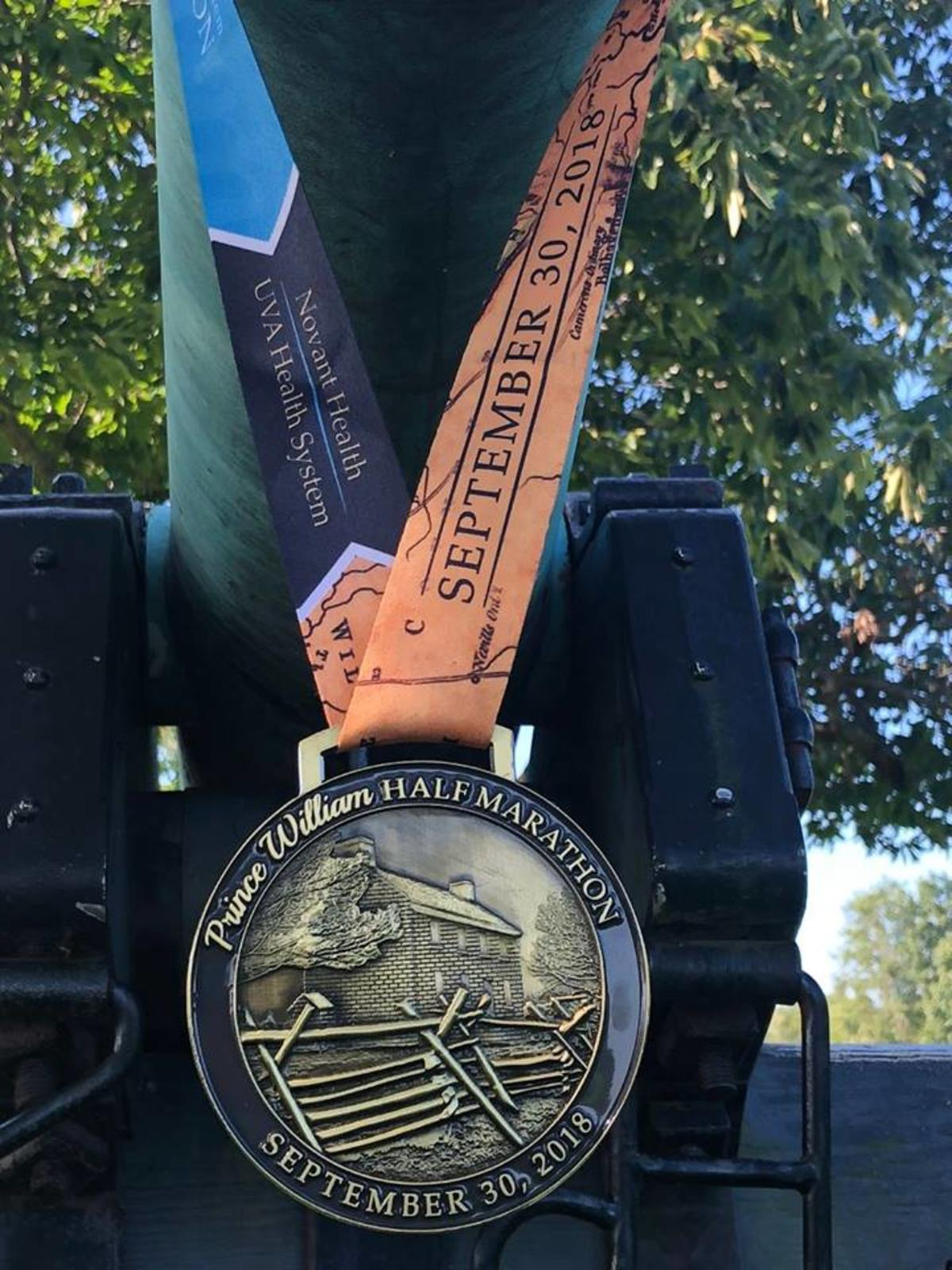 Half Marathon medal hanging from a cannon