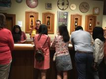 small group standing at the wine bar