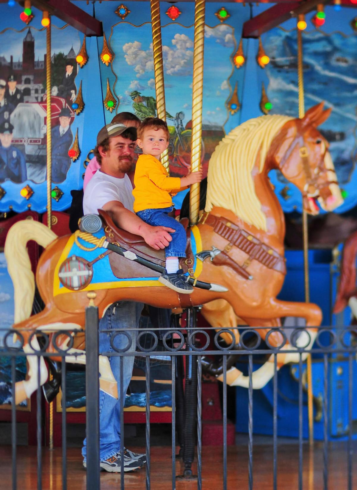 Dad and Son Riding the Carousel at Saginaw Children's Zoo
