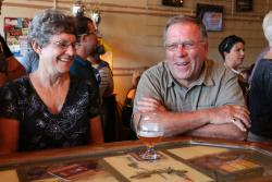 A couple laugh over freshly crafted beers at Hopping Gnome in Wichita