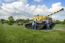 A family takes a closer look at an old tank on the Army Heritage Trail in Carlisle, PA.