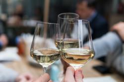 group toasting white wine