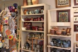 Shelves stocked full with items for sale inside of Artizanns