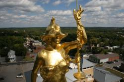 Lady Justice perched on top of the Ontario County Courthouse
