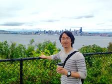 photo of a happy visitor from across the Pacific with Seattle Skyline in the background