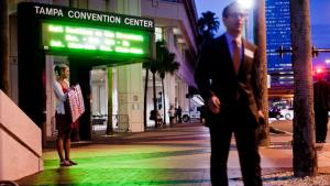 Supporters arrive to hear Mitt Romney speak at the Tampa Convention Center. Getty Images.
