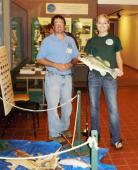Children of all ages will be able to take part in a variety of activities at the DEC's open house at the Salmon River Fish Hatchery in Altmar. Pictured are DEC aquatic biologist Jim Everard and Oswego County Public Information Officer Jessica Burt at last year's open house. Burt correctly identified a largemouth bass in the DEC's fish identification game.