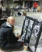 Window Project participant Kaitlyn works on her piece titled Trapped. Image credit:  June Leary