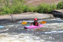 Nancy cheering on her way out of the rapids.
