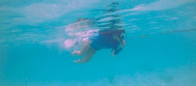 A snorkerler swimming near Guam