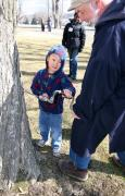 Museum Interpreter Wayne Coursen shows a young visitor how to tap a maple tree during last year's Sugaring Off Sundays event at The Farmers' Museum in Cooperstown, New York.