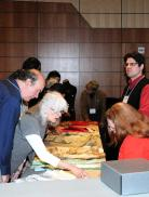 """Participants during a previous """"Material Matters"""" program examine original examples of 18th-century clothing. Fort Ticonderoga hosts the Fourth Annual """"Material Matters: It's in the Details"""" Seminar on January 25 & 26, 2014.. Registration is now open for this weekend seminar."""