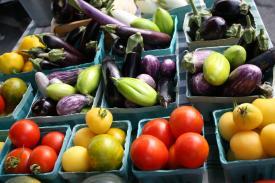 Fresh vegetables sit on sale at a local fresh farm market