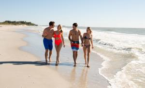 Two couples walking on beach at Don Pedro Island State Park