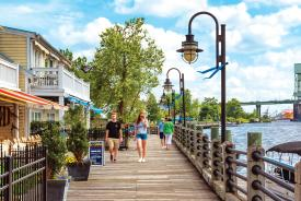 Couple walking on the Wilmington Riverwalk near restaurants