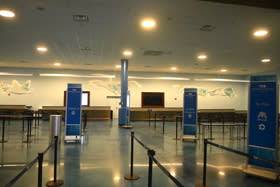 Beautiful artwork is displayed behind the check-in counters at Cruise Terminal 2, which services Princess Cruises