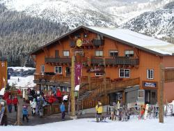 Skiiers and Snowboarders outside Central Lodge at Summit at Snoqualmie in the winter
